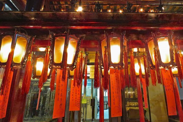 Glowing lamps decorated with red tassels hanging at Man Mo Temple
