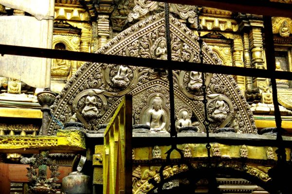 Intricate metal altarpiece with Buddha images of the Golden Temple Kwa Bahal, an 800 year-old Buddhist monastery in Patan, Kathmandu, Nepal.