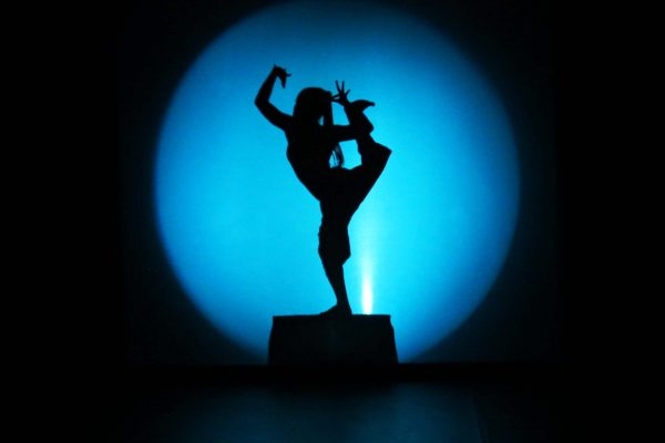 Sillouette of a female dancer at Phare Cambodia Circus