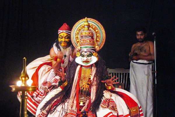 A Kathakali performance with actors in elaborate make up and costumes in Cochin, Kerala State, India