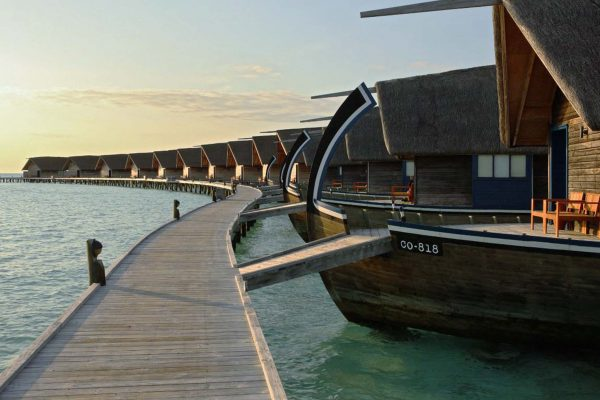 Cocoa Island Luxury Resort in the Maldives, where the overwater bungalows are designed to look like small wooden boats