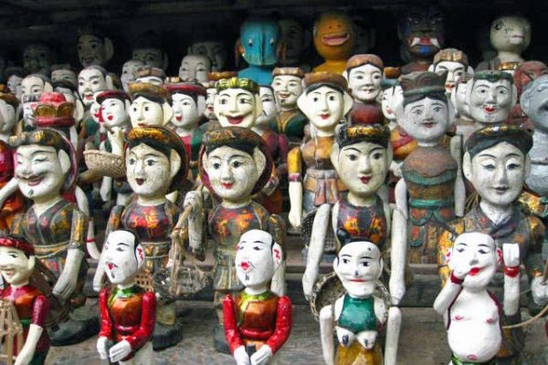Rows and rows of wooden water puppets await new homes at the Temple of Literature shop, Hanoi, Vietnam.