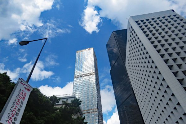 Puffy clouds and blue sky reflected on a Hong Kong highrise