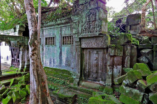 Beng Melea Temple covered in moss and vines