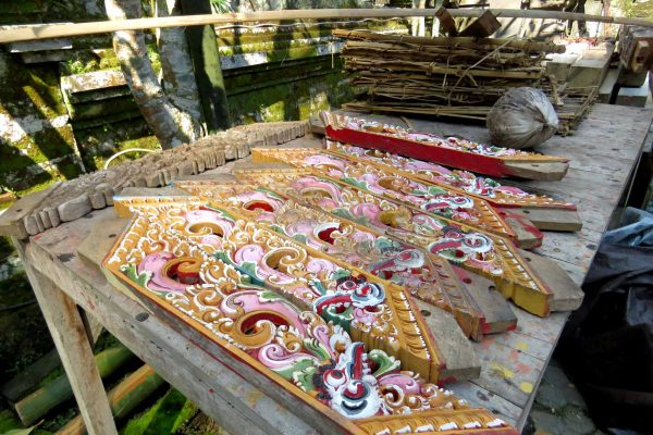 A workshop with paint drying on carved wooden trimming at Gunung Kawi Temple in Bali, Indonesia