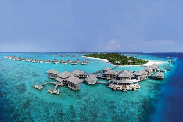 Six Senses Jaamu in the Maldives-- a luxury resort with overwater bungalows and turquoise water