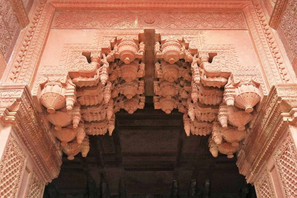 A pink sandstone intricately carved doorway in the Agra Fort, India
