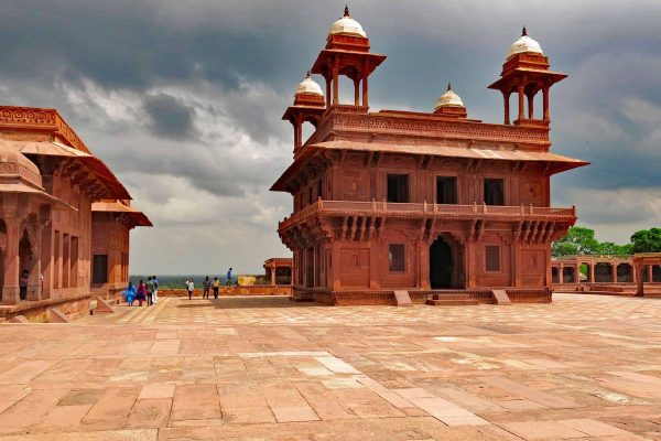 Fatephur Sikri, India: an imposing building in carved red sandstone under a dramatic sky.