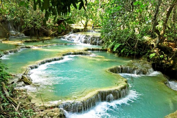 Turquoise pools of water forming below the Kuang-Si-Waterfall, Laos