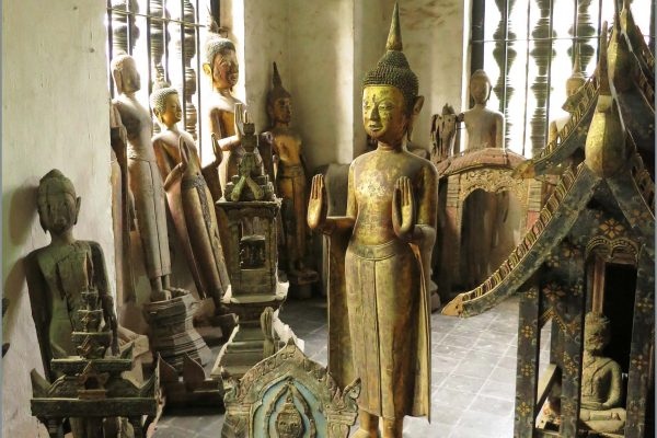 A room full of antique Buddha images in Wat Visoun, Luang Prabang, Laos.