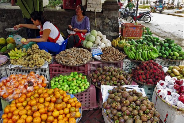 A roadside market selling fresh fruit (bananas, tamarind, mangosteens, oranges, etc) in Luang Prabang, Laos
