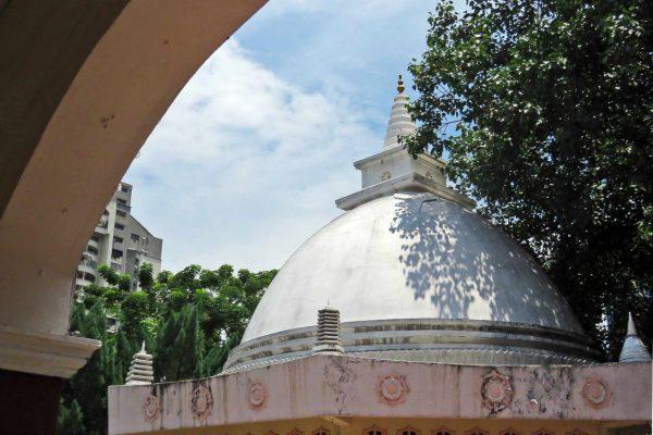 Large white dome of the Buddhist Maha Vihara stupa in Brickfields, Kuala Lumpur, Malaysia