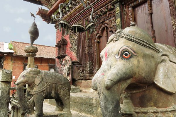 Elephant statues with painted eyes at the entrance of a temple in Patan, Kathmandu, Nepal