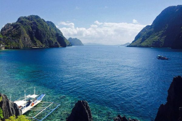 The islands of Palawan, clear blue water with hilly islands, The Philippines