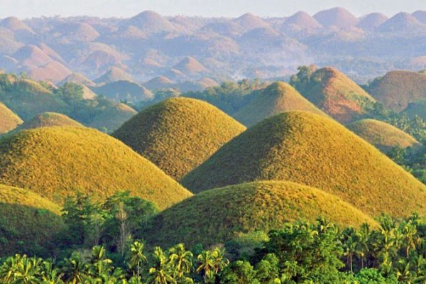 Chocolate Hills of Bohol, hundreds of small round hills across a plain, The Philippines
