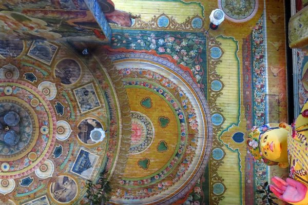 Exquisite ceiling painted with rings of a floral design in soft colors at the Gangaramaya Temple, Colombo, Sri Lanka.