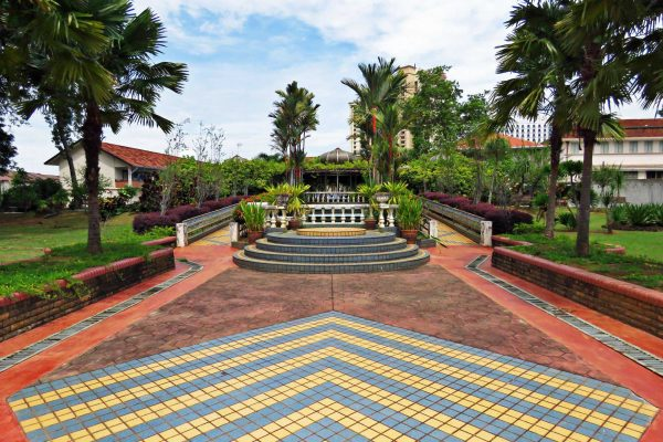 Diagonal tiles and palm trees in the Forbidden Garden of the Malacca Sultanate Palace, Melaka (Malacca), Malaysia.