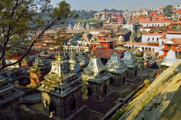 Early morning dappled light on a a row of shrines at the The sacred Hindu Pashupatinath Temple, along the banks of the Bagmati River, Kathmandu, Nepal.