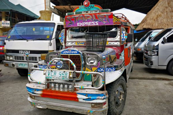 Starlet Express, a truck decorated with brightly painted panels, parked in Northern Luzon on the way to Banaue Rice Terraces , the Philippines